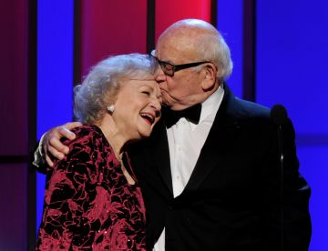Actors Betty White (L) and Ed Asner appear onstage at the 25th Anniversary Genesis Awards at the Century Plaza Hotel on March 19, 2011 in Los Angeles, California.  (Photo by Kevin Winter/Getty Images)