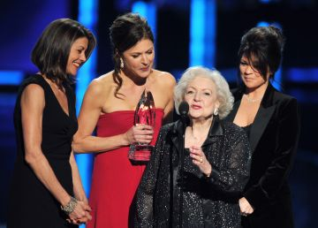 """Actresses Wendie Malick, Jane Leeves, Betty White and Valerie Bertinelli, winners Favorite Cable TV Comedy for """"Hot in Cleveland,"""" speak onstage at the 2012 People's Choice Awards at Nokia Theatre L.A. Live on January 11, 2012 in Los Angeles, California.  (Photo by Kevin Winter/Getty Images)"""