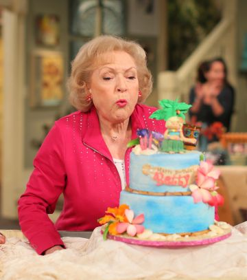 """Actress Betty White poses at the celebration of her 93rd birthday on the set of """"Hot in Cleveland""""  held at CBS Studios - Radford on January 16, 2015 in Studio City, California.  (Photo by Mark Davis/Getty Images for TV Land)"""