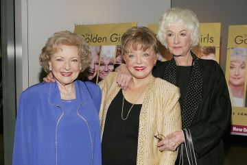 """(L to R)  Actresses Betty White, Rue McClanahan and Bea Arthur arrive for the DVD release party for """"The Golden Girls"""" the first season November 18, 2004 in Los Angeles, California. (Photo by Carlo Allegri/Getty Images)"""
