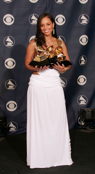 """2005:  Alicia Keys poses backstage with her awards for """"Best Female R & B Vocal Performance"""", """"Best R & B Performance by a Duo or Group With Vocals"""", """"Best R & B Song"""", and """"Best R & B Album"""" during the 47th Annual Grammy Awards at the Staples Center February 13, 2005 in Los Angeles, California.  (Photo by Carlo Allegri/Getty Images)"""