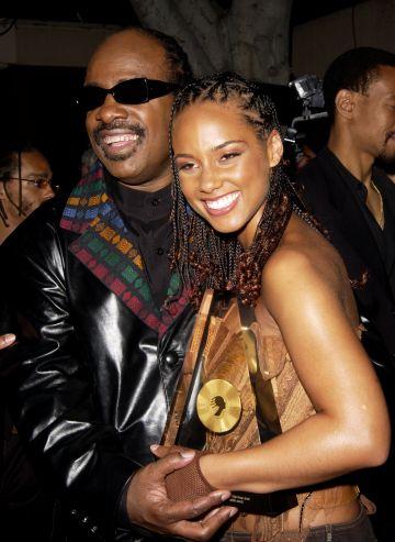2002: Stevie Wonder and Alicia Keys (Photo by J. Vespa/WireImage)