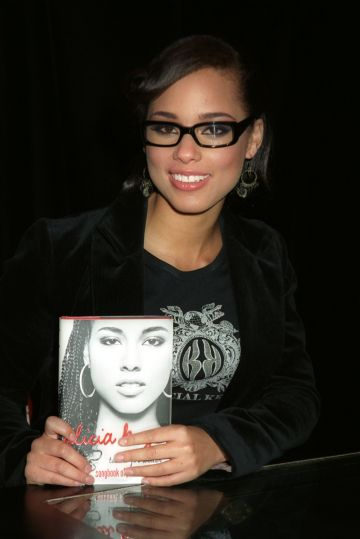 """2004:  Alicia Keys appearance in promotion of her book """"Tears for Water: Songbook of Poems and Lyrics"""" held at Book Soup in West Hollywood Calif. on November 11, 2004  (Photo by Christina Radish/Redferns)"""