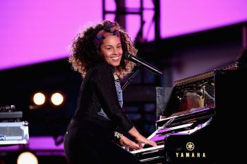 2016:  Alicia Keys performs in Times Square on October 9, 2016 in New York City.  (Photo by Gary Gershoff/Getty Images for Alicia Keys)