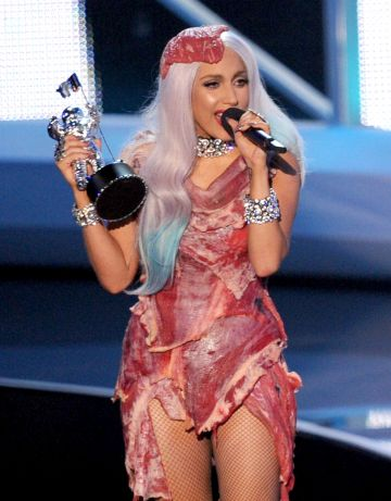 """Singer Lady Gaga wore the now infamous meat outfit at the  2010 MTV Video Music Awards at NOKIA Theatre L.A. LIVE on September 12, 2010 in Los Angeles, California.   She later explained  that she was also using the dress to highlight her distaste for the US military's """"don't ask, don't tell"""" policy. (Photo by Kevin Winter/Getty Images)"""