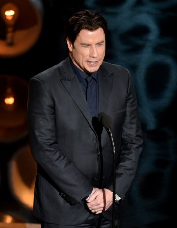 John Travolta struggled to pronounce Idina Menzel's name during the 2014 Oscars, instead calling her 'Adele Dazeem'.  (Photo by Kevin Winter/Getty Images)