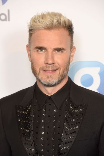 English singer songwriter Gary Barlow has made a name for himself as a solo artists and X Factor judge in recent years. He started his career with pop group Take That  in 1990 alongside Howard Donald and Mark Owen.   (Photo by Dave J Hogan/Getty Images)