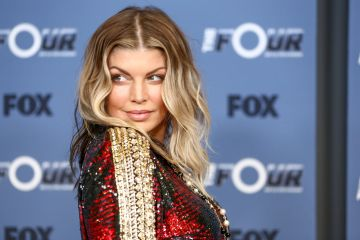 Fergie is best known as a solo artist and part of hip hop group Black Eyed Peas. She was originally part of girl group Wild Orchid as part of the Kids Incorporated TV show back in 2001.  (Photo by Rich Fury/Getty Images)
