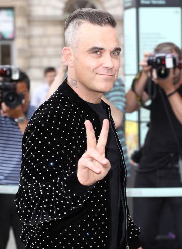 Alongside Gary Barlow, Robbie Williams started out in pop group Take That from 1990-1995. He went on to acheive greater success as a solo singer.  (Photo by John Phillips/Getty Images)