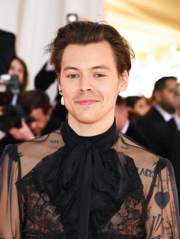 Harry Style entered The X Factor in 2010 as a solo artist before being placed in boy band One Direction. The band became one of the best selling boy bands of all time. Styles released a solo album in 2017 and has frequented the charts ever since.  (Photo by Dimitrios Kambouris/Getty Images for The Met Museum/Vogue)
