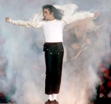 Michael Jackson performs during halftime of a 52-17 Dallas Cowboys win over the Buffalo Bills in Super Bowl XXVII on January 31, 1993 at the Rose Bowl in Pasadena California.  Photo credit: Getty Images