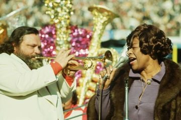 Ella Fitzgerald sings while Al Hirt plays the trumpet during the half-time show at the 1972 Superbowl. (Photo by Jerry Cooke/Corbis via Getty Images)