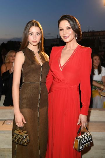 Catherine Zeta Jones and daughter Carys Zeta Douglas attend the Fendi Couture Fall Winter 2019/2020 Show on July 04, 2019 in Rome, Italy. (Photo by Daniele Venturelli/Daniele Venturelli/ Getty Images for Fendi)