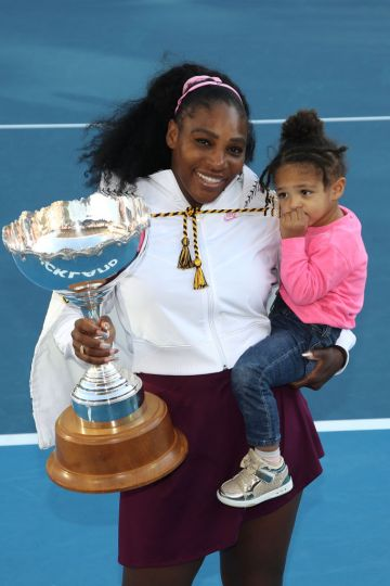 Serena Williams of the USA holds her daughter Alexis Olympia with the trophy following the Women's Final between Serena Williams and Jessica Pegula of the USA on day seven of the 2020 Women's ASB Classic at ASB Tennis Centre on January 12, 2020 in Auckland, New Zealand. (Photo by Phil Walter/Getty Images)