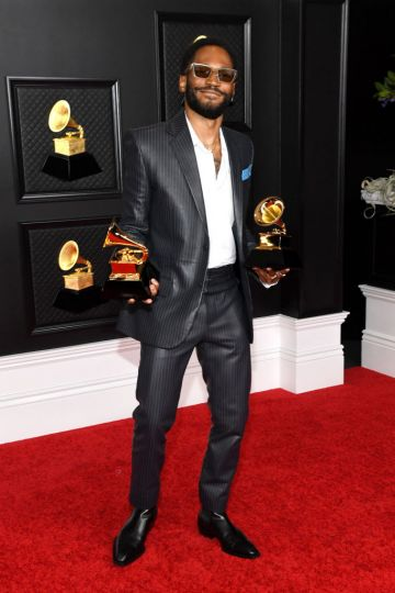 Kaytranada poses with the Grammy for Best Dance/Electronic Album and Best Dance Recording in the media room during the 63rd Annual GRAMMY Awards at Los Angeles Convention Center on March 14, 2021 in Los Angeles, California. (Photo by Kevin Mazur/Getty Images for The Recording Academy )