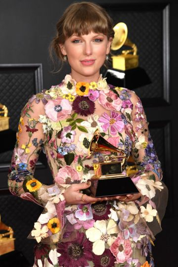 Taylor Swift, winner of the Album of the Year award for 'Folklore,' poses in the media room during the 63rd Annual GRAMMY Awards at Los Angeles Convention Center on March 14, 2021 in Los Angeles, California. (Photo by Kevin Mazur/Getty Images for The Recording Academy )