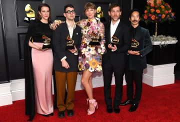 (L-R) Laura Sisk, Jack Antonoff, Taylor Swift, Aaron Dessner, and Jonathan Low, winners of the Album of the Year award for 'Folklore,' pose in the media room during the 63rd Annual GRAMMY Awards at Los Angeles Convention Center on March 14, 2021 in Los Angeles, California. (Photo by Kevin Mazur/Getty Images for The Recording Academy )