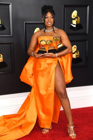 Megan Thee Stallion, winner of the Best Rap Performance and Best Rap Song awards for 'Savage' and the Best New Artist award, poses in the media room during the 63rd Annual GRAMMY Awards at Los Angeles Convention Center on March 14, 2021 in Los Angeles, California. (Photo by Kevin Mazur/Getty Images for The Recording Academy )