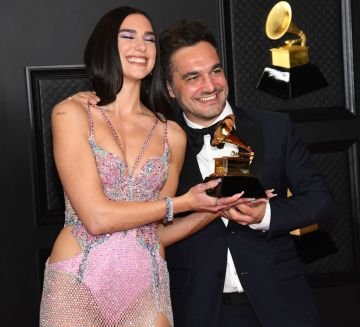 (L-R) Dua Lipa, winner of Best Pop Vocal Album for 'Future Nostalgia', and Ben Mawson pose in the media room during the 63rd Annual GRAMMY Awards at Los Angeles Convention Center on March 14, 2021 in Los Angeles, California. (Photo by Kevin Mazur/Getty Images for The Recording Academy )