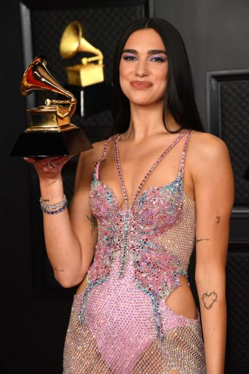 Dua Lipa, winner of Best Pop Vocal Album for 'Future Nostalgia', poses in the media room during the 63rd Annual GRAMMY Awards at Los Angeles Convention Center on March 14, 2021 in Los Angeles, California. (Photo by Kevin Mazur/Getty Images for The Recording Academy )