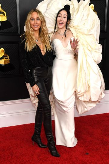 (L-R) Tish Cyrus and Noah Cyrus attend the 63rd Annual GRAMMY Awards at Los Angeles Convention Center on March 14, 2021 in Los Angeles, California. (Photo by Kevin Mazur/Getty Images for The Recording Academy )