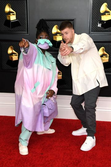 (L-R) Chika and Lido attend the 63rd Annual GRAMMY Awards at Los Angeles Convention Center on March 14, 2021 in Los Angeles, California. (Photo by Kevin Mazur/Getty Images for The Recording Academy )