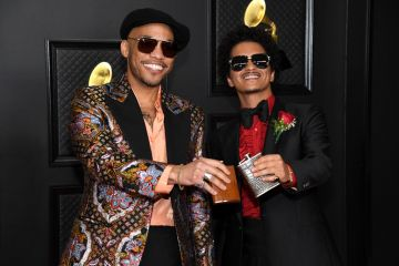 (L-R) Anderson .Paak and Bruno Mars attend the 63rd Annual GRAMMY Awards at Los Angeles Convention Center on March 14, 2021 in Los Angeles, California. (Photo by Kevin Mazur/Getty Images for The Recording Academy )