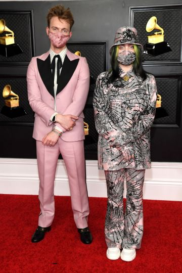 (L-R) FINNEAS and Billie Eilish attend the 63rd Annual GRAMMY Awards at Los Angeles Convention Center on March 14, 2021 in Los Angeles, California. (Photo by Kevin Mazur/Getty Images for The Recording Academy )