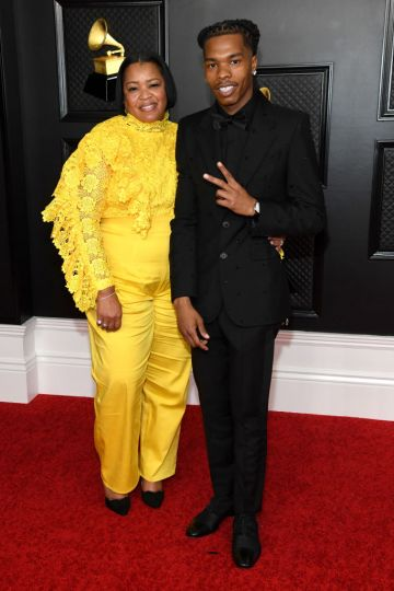 (L-R) Lashawn Jones and Lil Baby attend the 63rd Annual GRAMMY Awards at Los Angeles Convention Center on March 14, 2021 in Los Angeles, California. (Photo by Kevin Mazur/Getty Images for The Recording Academy )