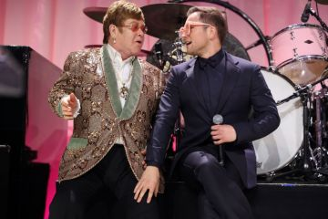 Sir Elton John and Taron Egerton perform onstage during the 27th annual Elton John AIDS Foundation Academy Awards Viewing Party sponsored by IMDb and Neuro Drinks celebrating EJAF and the 91st Academy Awards on February 24, 2019 in West Hollywood,California.  (Photo by Rich Fury/Getty Images for EJAF)