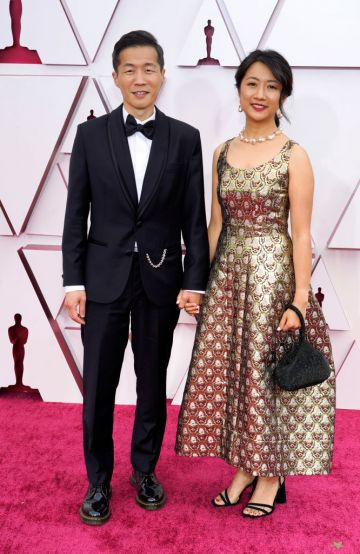 (L-R) Lee Isaac Chung and Valerie Chung attend the 93rd Annual Academy Awards at Union Station on April 25, 2021 in Los Angeles, California. (Photo by Chris Pizzello-Pool/Getty Images)