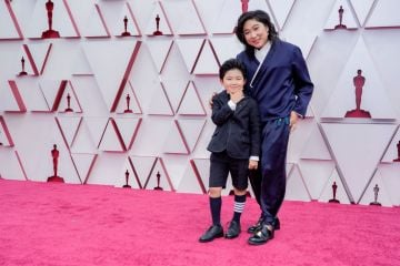 (L-R) Alan S. Kim and Christina Oh attend the 93rd Annual Academy Awards at Union Station on April 25, 2021 in Los Angeles, California. (Photo by Chris Pizzello-Pool/Getty Images)
