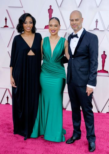 (L-R) Dionne Harmon, Jeannae Rouzan Clay, and Jesse Collins attend the 93rd Annual Academy Awards at Union Station on April 25, 2021 in Los Angeles, California. (Photo by Chris Pizzello-Pool/Getty Images)