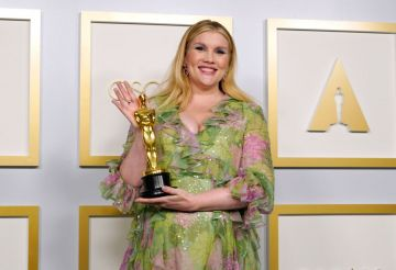 """Emerald Fennell, winner of Best Original Screenplay for """"Promising Young Woman,"""" poses in the press room at the Oscars on Sunday, April 25, 2021, at Union Station in Los Angeles. (Photo by Chris Pizzello-Pool/Getty Images)"""