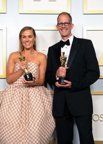 Dana Murray and Pete Docter, winners of the Animated Feature Film award for 'Soul,' pose in the press room during the 93rd Annual Academy Awards at Union Station on April 25, 2021 in Los Angeles, California. (Photo by Matt Petit/A.M.P.A.S. via Getty Images)