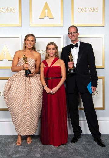 (L-R) Pete Docter, Dana Murray and Reese Witherspoon winners of the Animated Feature Film award for 'Soul' poses in the press room during the 93rd Annual Academy Awards at Union Station on April 25, 2021 in Los Angeles, California. (Photo by Matt Petit/A.M.P.A.S. via Getty Images)