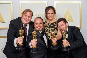 Phillip Bladh, Carlos Cortés, Michelle Couttolenc and Jaime Baksht pose with the Best Sound award for 'The Sound of Metal' in the press room during the 93rd Annual Academy Awards at Union Station on April 25, 2021 in Los Angeles, California. (Photo by Matt Petit/A.M.P.A.S. via Getty Images)