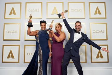 (L-R) Mia Neal, Jamika Wilson, and Sergio Lopez-Rivera pose backstage with the Oscar for Makeup and Hairstyling in the press room during the 93rd Annual Academy Awards at Union Station on April 25, 2021 in Los Angeles, California. (Photo by Matt Petit/A.M.P.A.S. via Getty Images)
