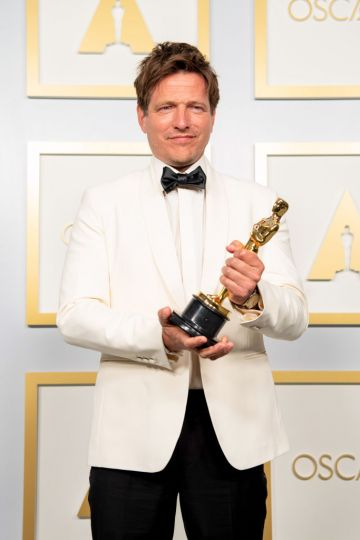 Thomas Vinterberg, winner of the International Feature Film award for 'Another Round,' poses in the press room during the 93rd Annual Academy Awards at Union Station on April 25, 2021 in Los Angeles, California. (Photo by Matt Petit/A.M.P.A.S. via Getty Images)