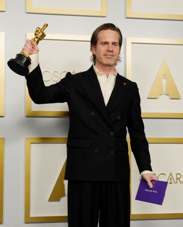 """Mikkel E. G. Nielsen, winner of Best Film Editing for """"Sound of Metal,"""" poses in the press room during the Oscars on Sunday, April 25, 2021, at Union Station in Los Angeles. (Photo by Chris Pizzello-Pool/Getty Images)"""