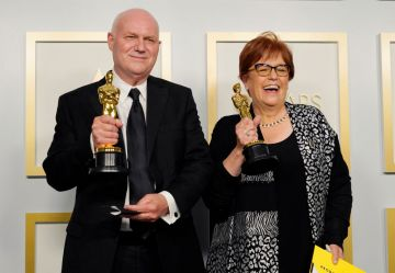 """Donald Graham Burt and Jan Pascale, winners of Best Production Design for """"Mank"""", pose in the press room during the Oscars on Sunday, April 25, 2021, at Union Station in Los Angeles. (Photo by Chris Pizzello-Pool/Getty Images)"""