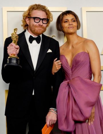 """Erik Messerschmidt, winner of Best Cinematography for """"Mank"""", poses with Halle Berry in the press room during the Oscars on Sunday, April 25, 2021, at Union Station in Los Angeles. (Photo by Chris Pizzello-Pool/Getty Images)"""