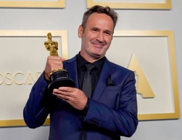 """Scott R. Fisher, winner of Best Visual Effects for """"Tenet"""", poses in the press room during the Oscars on Sunday, April 25, 2021, at Union Station in Los Angeles. (Photo by Chris Pizzello-Pool/Getty Images)"""