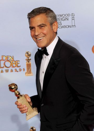 """Actor George Clooney poses in the press room with the Best Performance by an Actor in a Motion Picture - Drama  award for """"The Descendants"""" at the 69th Annual Golden Globe Awards held at the Beverly Hilton Hotel on January 15, 2012 in Beverly Hills, California.  (Photo by Kevin Winter/Getty Images)"""