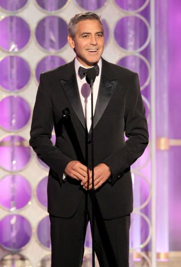 George Clooney presents an award onstage during the 69th Annual Golden Globe Awards at the Beverly Hilton International Ballroom on January 15, 2012 in Beverly Hills, California. (Photo by Paul Drinkwater/NBC via Getty Images)