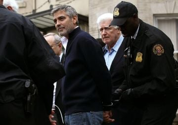 Actor George Clooney (L) is arrested with his father Nick Clooney (2R) during a demonstration outside the Embassy of Sudan March 16, 2012 in Washington, DC. United to End Genocide, the Enough Campaign and Amnesty International held a rally to call on the United States and world leaders to stop the violence in South Sudan and prevent hundreds of thousands of people from starving.  (Photo by Win McNamee/Getty Images)