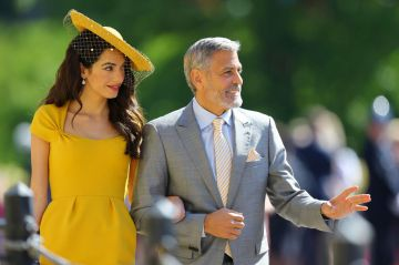 Amal Clooney and George Clooney arrive at St George's Chapel at Windsor Castle before the wedding of Prince Harry to Meghan Markle on May 19, 2018 in Windsor, England. (Photo by Gareth Fuller - WPA Pool/Getty Images)