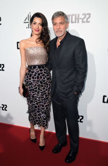 """Amal Clooney and George Clooney attend the """"Catch 22"""" UK premiere at the Vue Westfield on May 15, 2019 in London, United Kingdom. (Photo by Karwai Tang/WireImage)"""