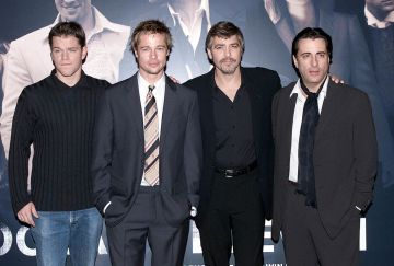 """American actors (L-R) Matt Damon, Brad Pitt, George Clooney and Andy Garcia attend a photocall to promote their new film """"Ocean's Eleven"""" at the Dorchester Hotel on November 2, 2001 in London. (Photo by Dave Hogan/Getty Images)"""