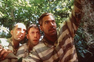 """In The Depression-Era Deep South (From L-R), Three Escapees From A Mississippi Prison Chain Gang: Pete (John Turturro), Delmar (Tim Blake Nelson) And Everett Ulysses Mcgill (George Clooney), Embark On The Adventure Of A Lifetime As They Set Out To Pursue Their Freedom And Return To Their Homes, In Touchstone Pictures/Universal Pictures' Drama, """"O Brother, Where Art Thou?"""" (Tentative Title).  (Photo By Getty Images)"""